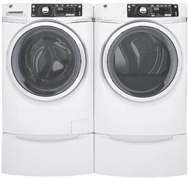 "White Front Load Laundry Pair with GFW480SSKWW 28"" Front Load Washer, GFD48ESSKWW 28"" Electric Dryer and 2 GFP1328SKWW Pedestals"